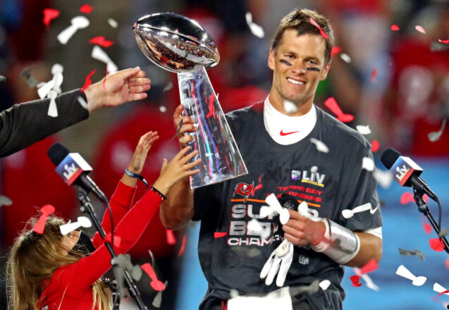 Feb 7, 2021; Tampa, FL, USA;  Tampa Bay Buccaneers quarterback Tom Brady (12) celebrates with the Vince Lombardi Trophy after beating the Kansas City Chiefs in Super Bowl LV at Raymond James Stadium.  Mandatory Credit: Mark J. Rebilas-USA TODAY Sports